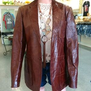 Vintage brown patch work leather jacket.